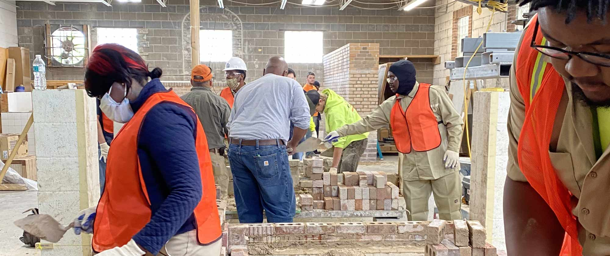 Building Union Diversity (BUD) workers building with bricks in a shop